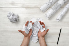 Masculine hands palm up with pieces of paper Stock Images