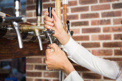 Masculine hands pouring beer Royalty Free Stock Photo