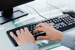 Masculine hands typing Royalty Free Stock Image
