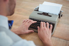 masculine hands typing on old typewriter Stock Photo
