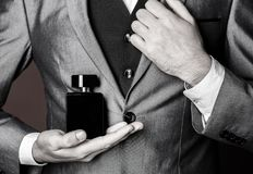 Masculine perfume. Perfume or cologne bottle. Man perfume, fragrance. Male fragrance and perfumery, cosmetics. Man. Masculine perfume. Man perfume, fragrance royalty free stock image