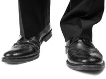 Masculine suit wearing black shoes approaching Royalty Free Stock Images