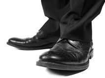 Masculine suit wearing black shoes. Towards white Royalty Free Stock Images