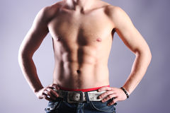 Masculinity. Strong sexy body in dark Royalty Free Stock Photos