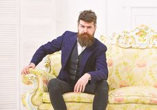 Masculinity concept. Man with beard and mustache wearing classic suit, stylish fashionable outfit. Macho attractive and. Elegant on serious, thoughtful face royalty free stock images
