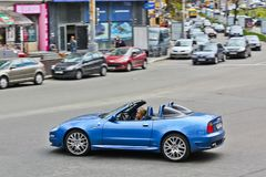 Kiev, Ukraine; April 10, 2014. Maserati Cabrio 4.2 V8. The girl behind the wheel. stock photo