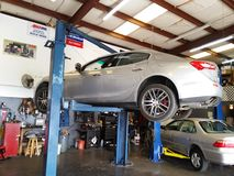 Maserati on the lift. On the lift in the shop getting some attention Stock Photography