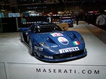 Maserati MC12. A blue Maserati MC12 in GT1 specifications exposed at the 2004 Geneva Autoexpo. Prepared for the FIA GT championship on the basis of the Ferrari Royalty Free Stock Image