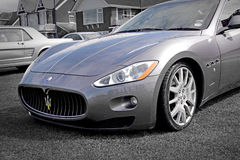 Maserati sports car. Photo of a wet maserati sports car showing at the whitstable vintage car show on 17th august 2014.photo ideal for vintage cars and vehicles Stock Photography