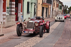 Maserati tipo 26M 8C 2500 1930 in Mille Miglia 2017. Driver and co-driver on an old competition car Maserati tipo 26M 8C 2500 1930 in historical classic car race Royalty Free Stock Photo