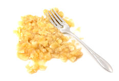 Mashed banana flesh with a fork Stock Photo
