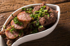 Mashed beans with sausage called Tutu de Feijao in Brazil Royalty Free Stock Image