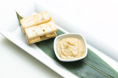 Mashed garlic sauce with bread croutons Stock Image