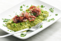 Mashed peas. With fried pancetta Stock Photography