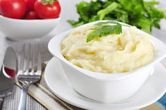 Mashed potato. In white plate with greenery and tomatoes stock photos