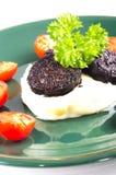 Mashed potato and black pudding Stock Photo