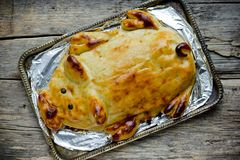 Mashed potato casserole shaped funny pig like a real. Festive dinner dish for Christmas, new year or easter royalty free stock images