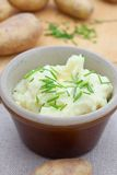Mashed potato in a dish with chopped chives Royalty Free Stock Photo