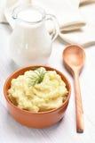Mashed potato and jug of milk Stock Photography