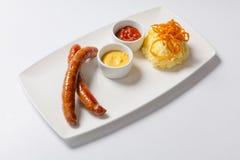 Mashed potato and roasted sausage. And sauce stock photo
