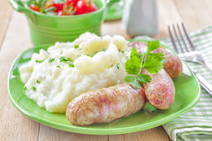 Mashed potato with sausages Stock Photos