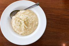 Mashed potato with a spoon royalty free stock photos