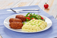 Mashed potato sprinkled with greens, cuttlets and salad Royalty Free Stock Photography