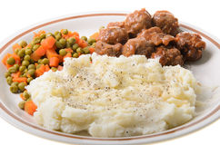 Mashed Potatoes. An american supper of mashed potatoes, with sweet and sour meatballs with peas and carrots Royalty Free Stock Image