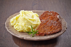 Mashed potatoes and beef steak Royalty Free Stock Images