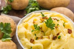 Mashed potatoes in bowl decorated with parsley herbs. Royalty Free Stock Images