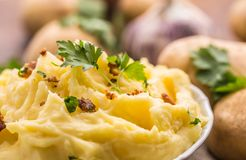 Mashed potatoes in bowl decorated with parsley herbs. Stock Photography