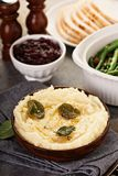 Mashed potatoes with butter and sage. Side dish for Thanksgiving or Christmas dinner stock photography