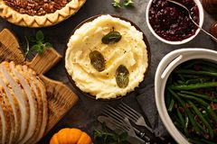 Mashed potatoes with butter and sage. Side dish for Thanksgiving or Christmas dinner overhead shot stock image