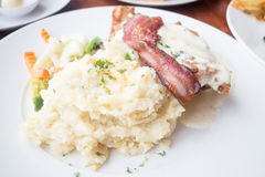Mashed potatoes with crispy piece of bacon Stock Photo