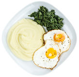 Mashed Potatoes with fried eggs and spinach isolated on white Royalty Free Stock Photography