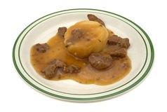 Mashed potatoes with gravy and beef tips TV dinner Stock Photo