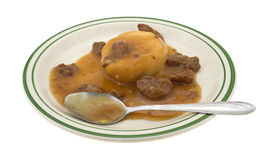 Mashed potatoes gravy and beef tips TV dinner with spoon Stock Photo