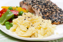 mashed potatoes, pink salmon fillet with sesame and vegetables Stock Photography