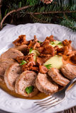 Mashed potatoes with pork medallions and chanterelle sauce Stock Photography