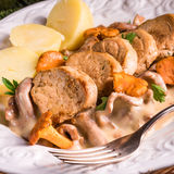 Mashed potatoes with pork medallions and chanterelle sauce Royalty Free Stock Images