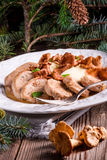 Mashed potatoes with pork medallions and chanterelle sauce Stock Photos