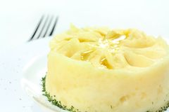 Mashed potatoes, poured melted butter Royalty Free Stock Photos