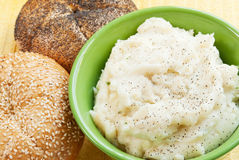 Mashed Potatoes and Rolls. Homemade mashed potatoes covered with black pepper with two kaiser rolls on the side. Selective focus and shallow DOF Royalty Free Stock Photography