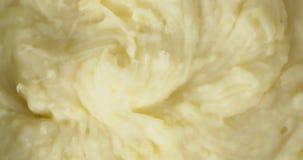 Mashed potatoes rotates slowly. Macro background.