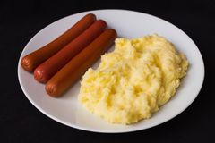 Mashed potatoes sausages dark background. Photo taken June 28, 2015 home studio, Czech Republic Stock Photo