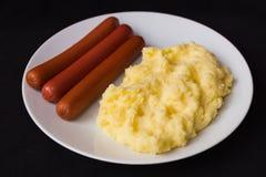 Mashed potatoes sausages dark background stock photo