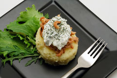 Mashed potatoes with shrimps and creamy cheese. On a black plate stock photography