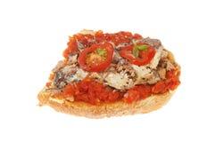 Sardine on toast. Mashed sardine with tomato on toast isolated against white Stock Photo