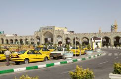 Mashhad. Iranian taxi along the street outside the Imam Reza Shrine, a complex which contein a mausoleum of Imam Reza, the ieght Imam of the Twelver Shiites royalty free stock photography