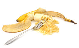 Mashing a peeled overripe banana with a fork Stock Images